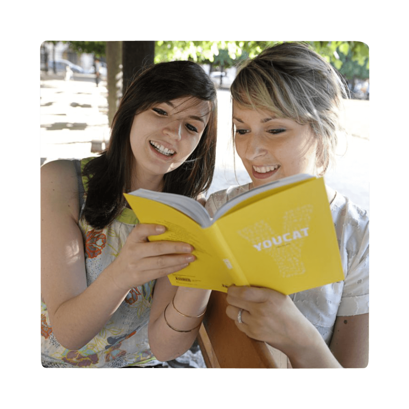 2 young girls studying the youcat book