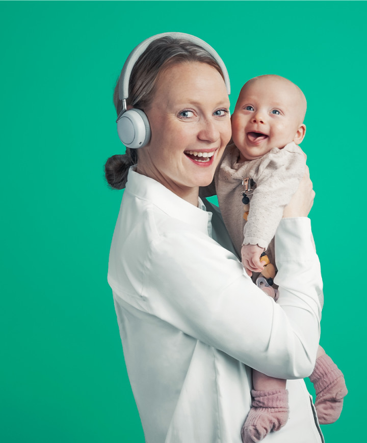Happy mother Listening to podcasts with her child