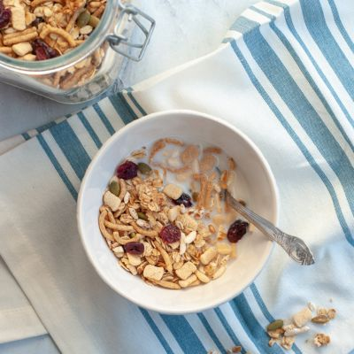 granola cereal with milk in a bowl