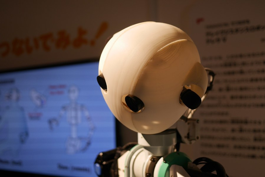 A photo of the head and upper torso of a robot.