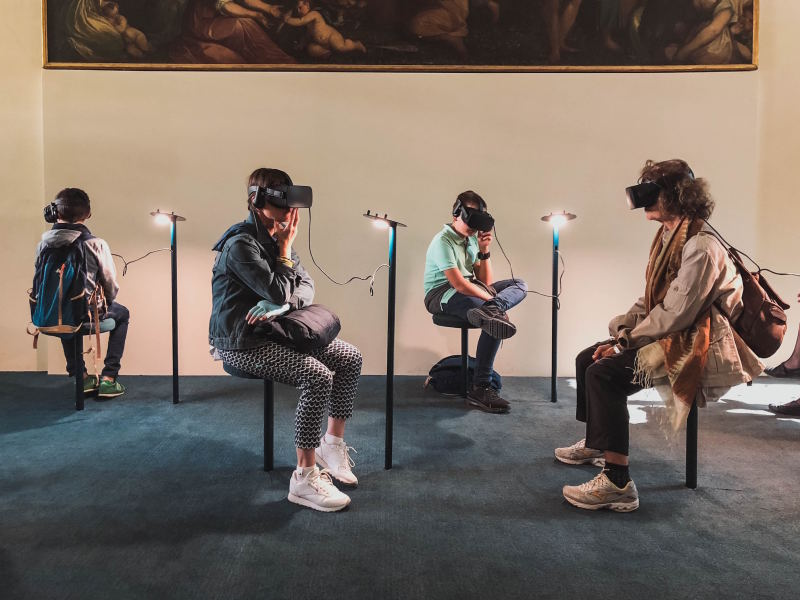 Four people using VR headsets.