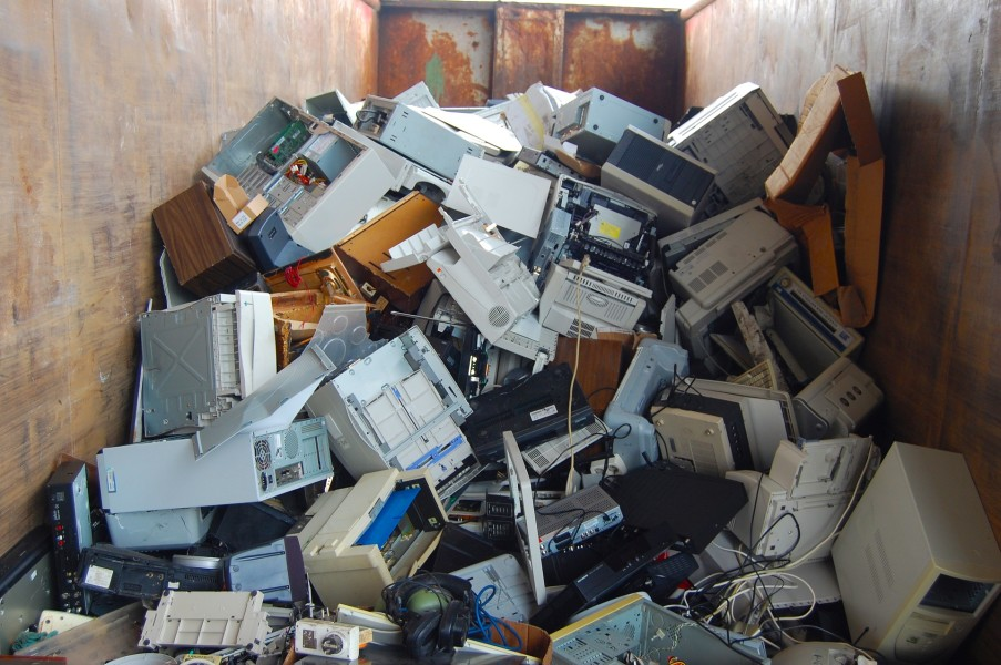 A photo of a pile of discarded computer equipment.
