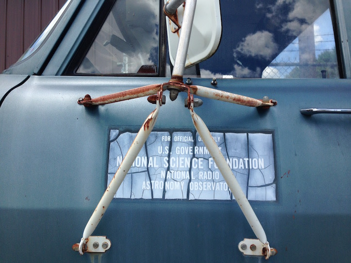 "Side of a truck with a plaque that reads ""US Government National Science Foundation National Radio Astronomy Observatory"""