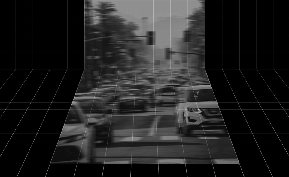 A blurred black and white image of car traffic, on a black grid