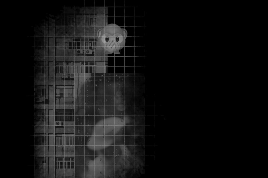 darkened image of an apartment building with a monkey emoji over top