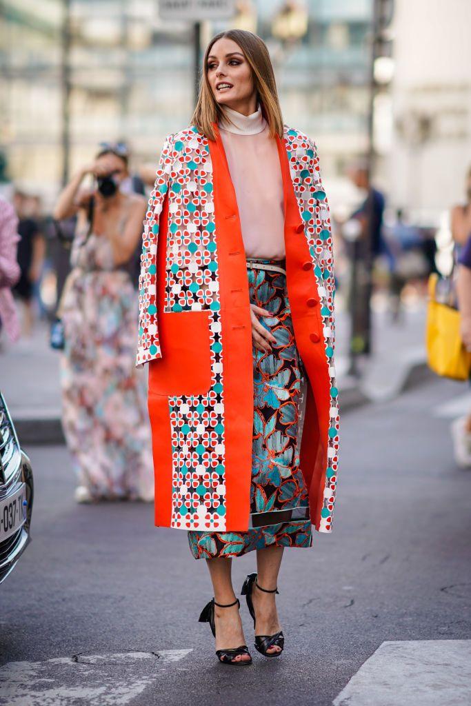 Olivia Palermo wears a flower print kimono jacket, a pink top, a