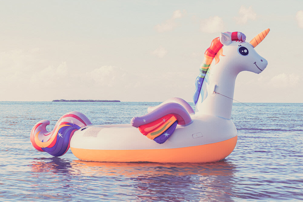 An inflatable unicorn on water.