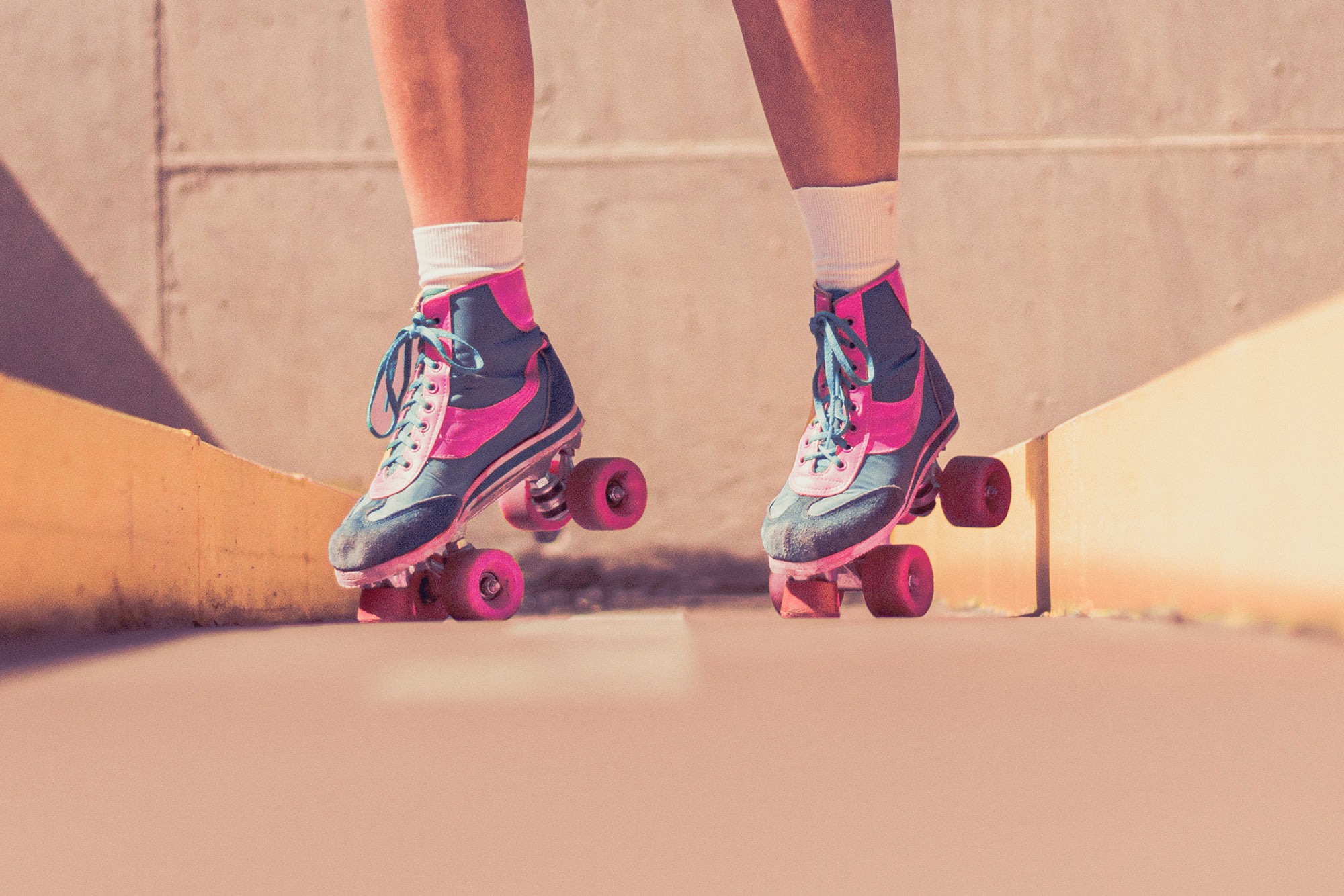 A person on roller skates, tilted on their toes.