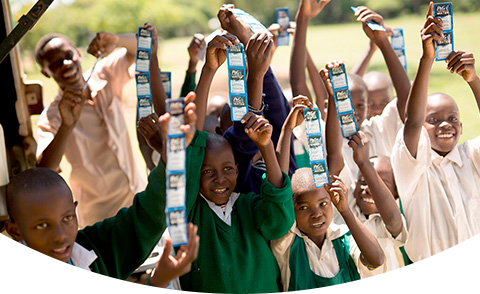 CSDW Happy kids showing purifying water packets