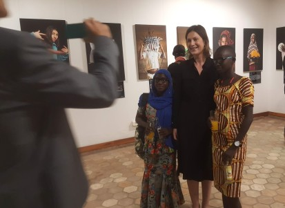 """Jutta Hinkkanen, Head of OCHA Burundi, with Ghyslaine and Lydia, who participated in the photo exhibition """"One day, I will"""" by Vincent Tremeau. Photo © OCHA 2020/Lauriane Wolfe"""