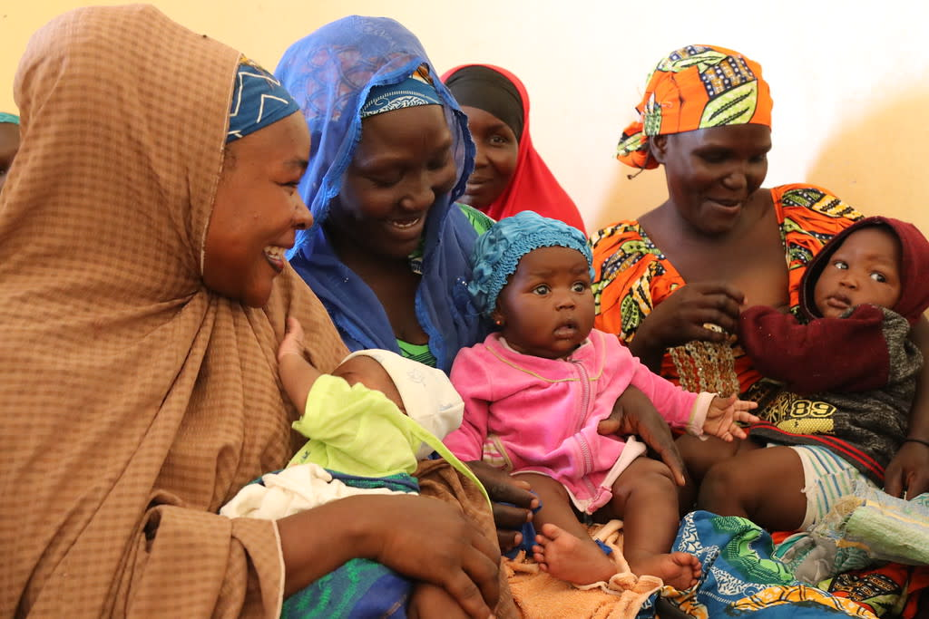 Mothers and children at a nutrition center in the Lac province