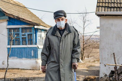 """Mykola is standing in his yard in village at the """"contact line"""""""