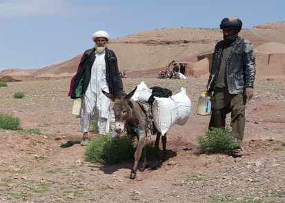 Food Distribution for drought-affected families in Kohi Zor, Hirat, May 2019.