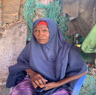Hadiyo Mohamed seated in-front of her make-shift shelter in Gardoush settlement along the coastal area of Bari Region Somalia. Photo: Ayub Ahmed/UNOCHA
