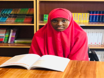 Shukri in the Library reading books-