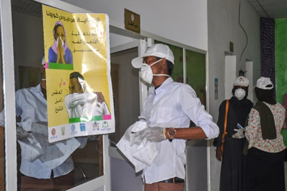 Community members in White Nile distributing COVID posters and sanitation products at a local hospital UNDP