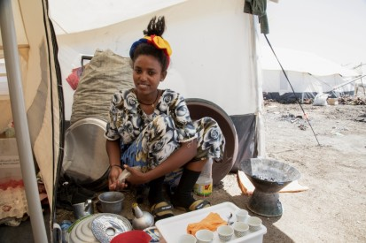 Anna* prepares traditional coffee in the kitchen area of her tent in Tunaydbah refugee settlement, eastern Sudan.  © UNHCR/Ahmed Kwarte