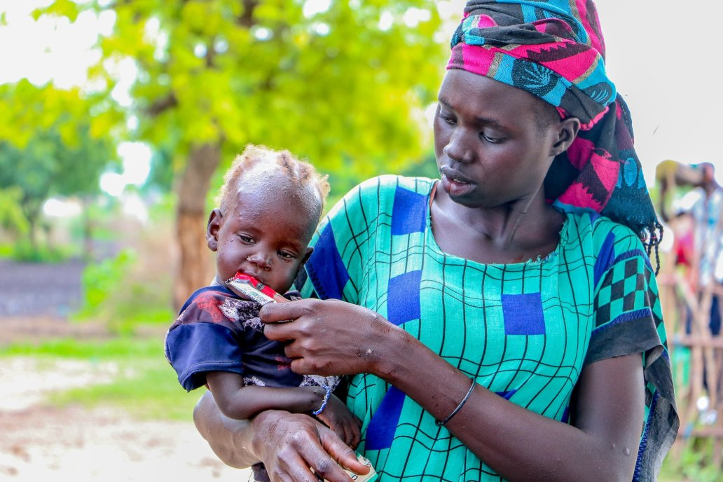 In Akobo, a mother feeds her child nutritious supplementary food. More than 6.35 million people were severely food insecure in August. Credit: Medair
