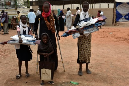 Female headed household receiving NFIs Bantiu Khartoum UNHCR Jan2019