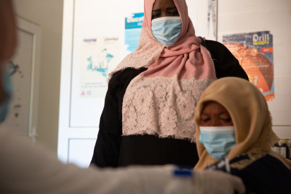 Fatima at a primary health care centre in Gergaresh, Tripoli (UNHCR/Mohamed Alalem)