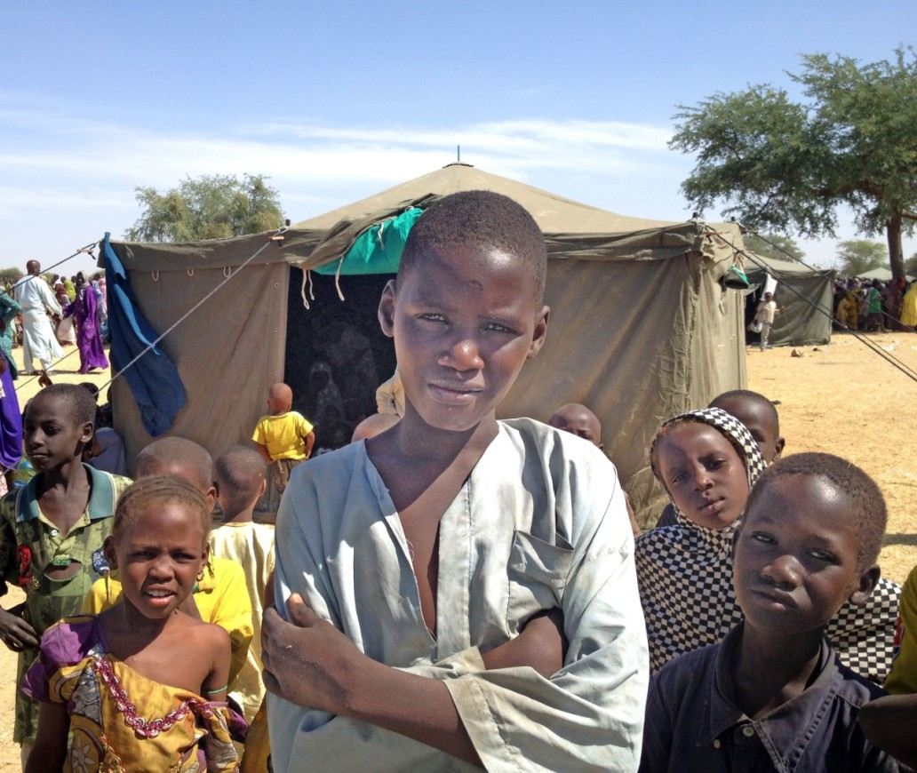 NIGER: Kid with crossed arms in IDPs camp