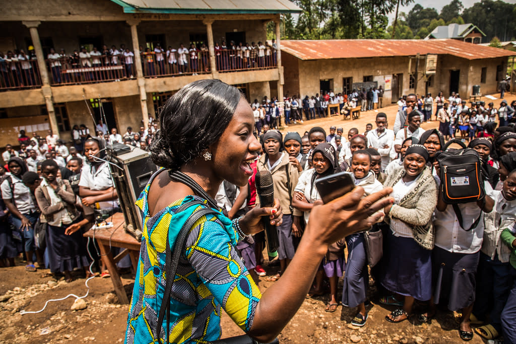 Huguette Mulyanza speaks to students attending La Vérité school about how she survived Ebola in Buntembo, North-Kivu province, Democratic Republic of the Congo on 21 March 2019