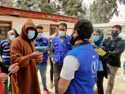 The humanitarian team visiting a displacement camp in Tarhouna and listening to the needs of displaced Tawerghans (OCHA/Ahmed Rih)