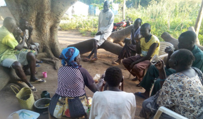 Community members discuss gender-based violence as they enjoy a cup of coffee in Mundri, Western Equatoria. Credit: Active Youth Association/Achan