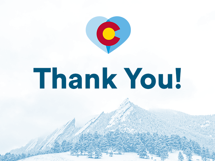 A heart overlaid on the Colorado flag with the Boulder Flatirons in the background with Thank you spelled out