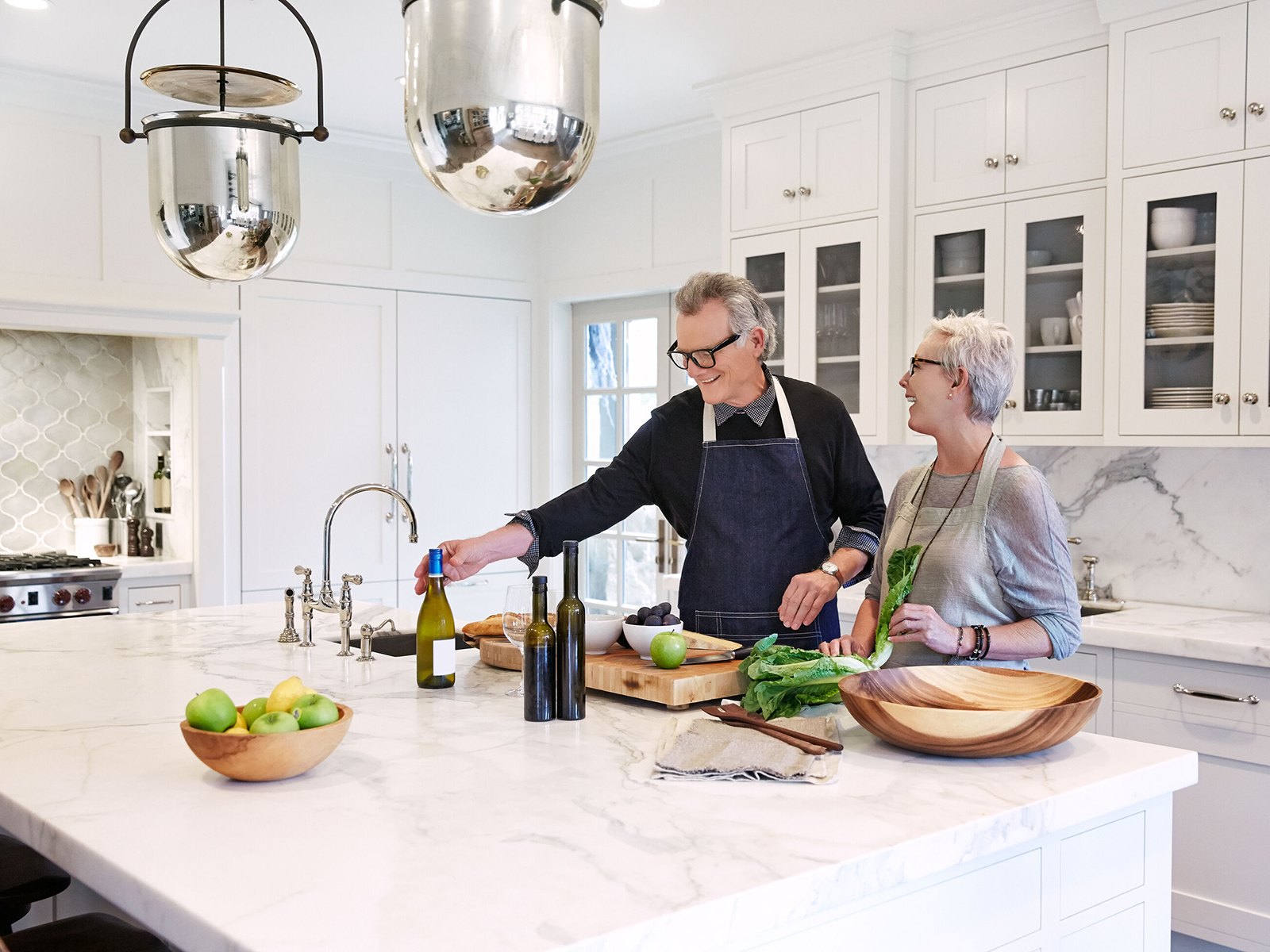 Husband and wife cook together in their newly remodeled kitchen
