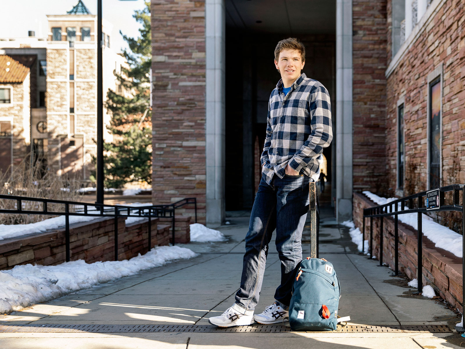 College student standing with backpack on campus