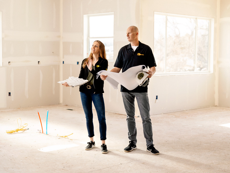 A man and woman working on a commercial project.