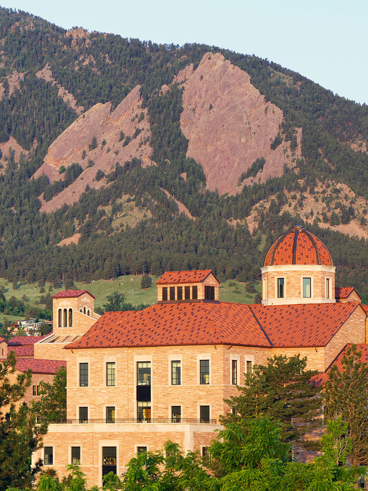 University of Colorado campus building with flatirons in background