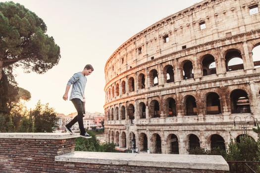 man walking near italian colosseum