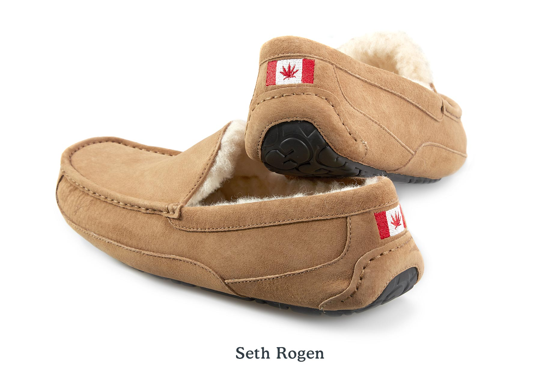 A pair of UGG Slippers for Seth Rogen with embroidery of a Canadian flag on the heel