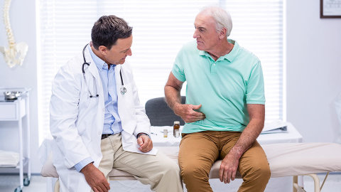 Doctor with patient discussing bowel cancer