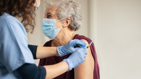 A woman about to get the COVID-19 vaccine