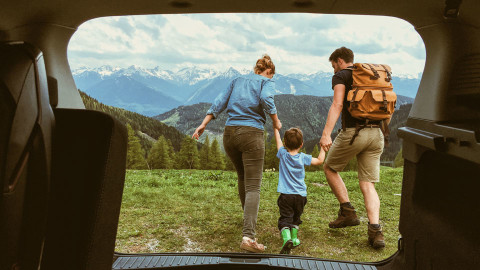 Young couple with toddler exploring a mountain range
