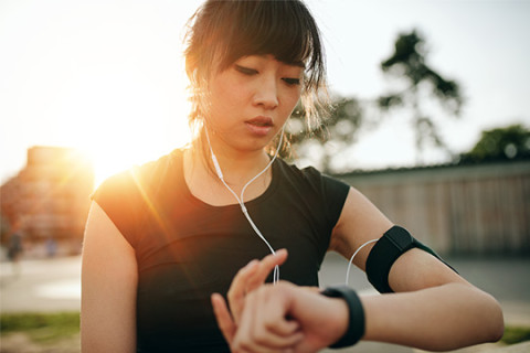 Young woman checking her vital signs using her fitness tracker