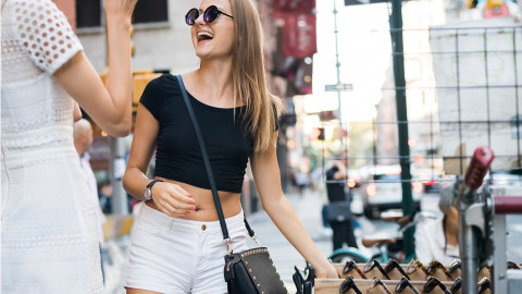 Young girl shopping for sunglasses