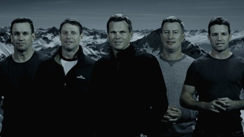 Past Newcastle Knights players standing in front of Mt Everest