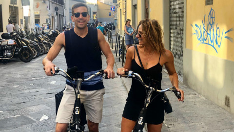 Cassey Maynard and her boyfriend riding bikes overseas