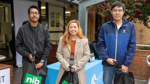 International students at the University of Newcastle receiving health and hygiene packages from nib health insurance.