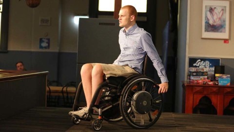 alex mckinnon on a stage discussing his fitness and health goals