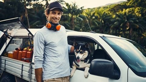 Young tradie with his ute and work dog talking about what to claim on tax