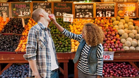 A couple mucking around at a farmers market