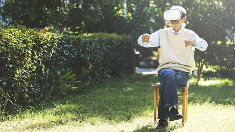 elderly man with alzheimer's using virtual reality bike to bring back memories