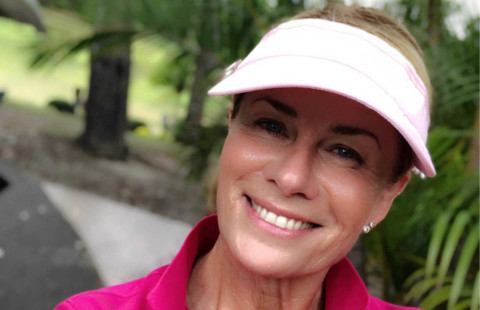 Deborah Hutton wearing a visor in the outdoors
