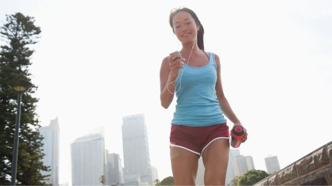 Young brunette woman in the CBD trying to exercise and keep healthy while surrounded by bushfire smoke