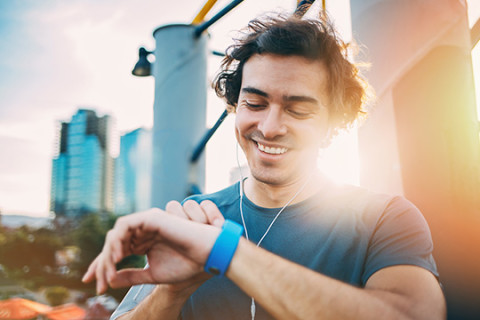Young man managing his health with a fitness tracker